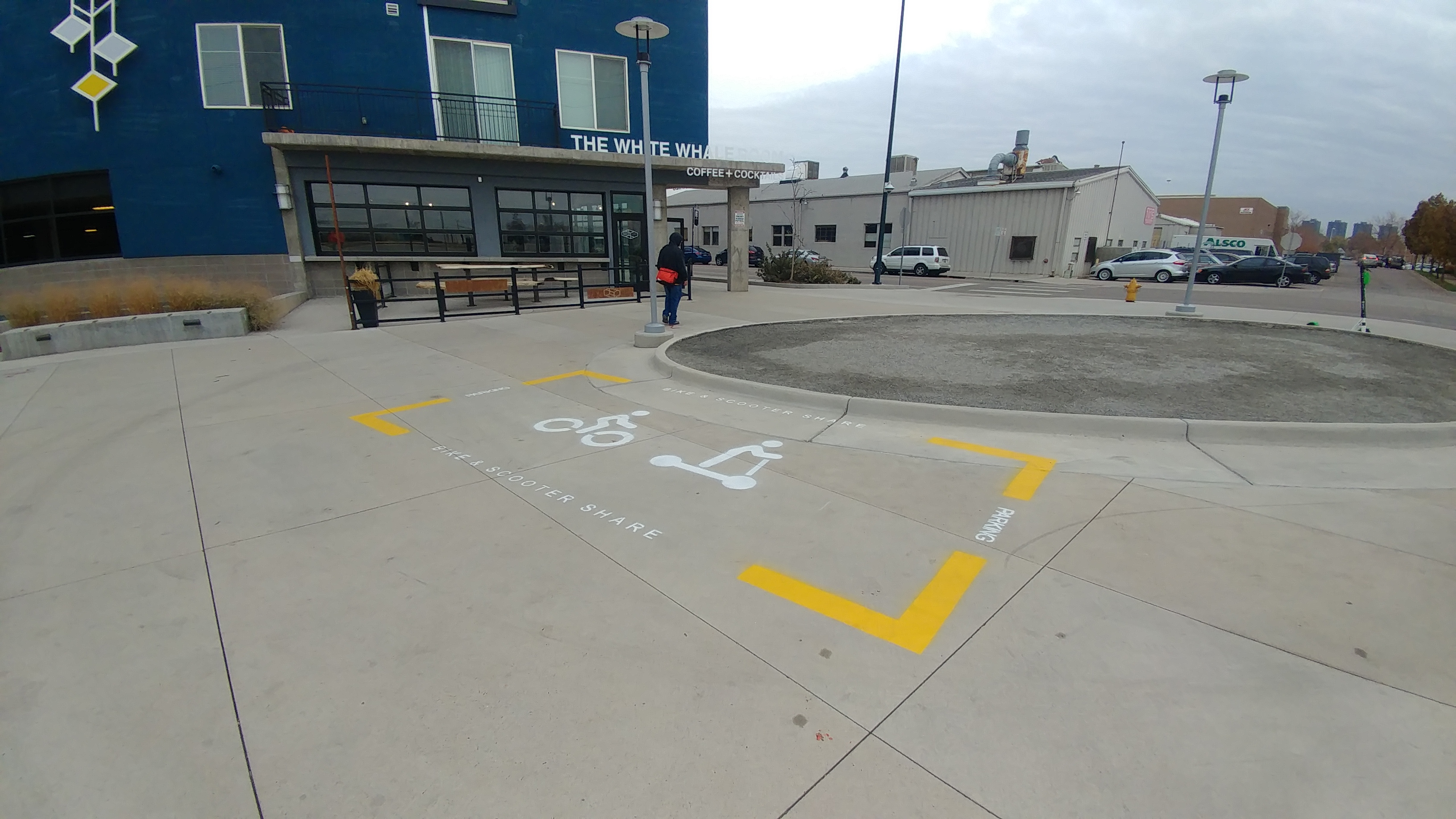 Stenciled parking areas for dockless bikes and scooters